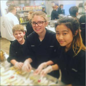 Robbie, Taylor, and Rachel working on endive salad