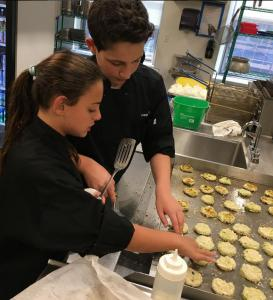 Samantha and Aiden working on Avocado Crab Cakes