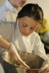 Culinary program student working on a recipe at campusNYC!