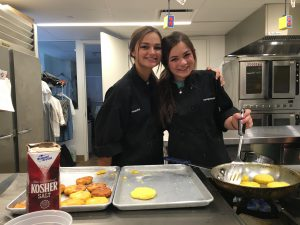 2 students from Dallas, TX enjoying the summer cooking class in NYC!